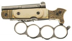 Belgian percussion knife combination with folding knuckleduster grip,which forms pistol grip when locked into place. Lovely thing