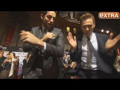 Two men in suits showing off their moves, getting us ready for Thor 2