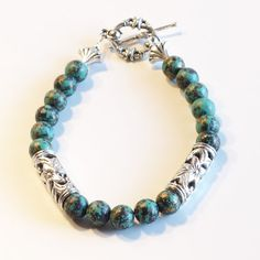 Check out OLIVE & TURQUOISE Women's stackable bracelet, stacking bracelet, statement bracelet, beaded bracelet on dunglebees