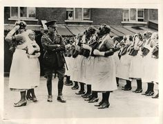 1935- Major John Dixon, Royal Army Medical Corps, inspecting gas-masked nurses during demonstration of first-aid work in the event of a gas attack staged in the East End of London.