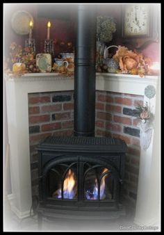 GoldCountryCottage: Love this for my pellet stove.change the bricks to repurposed wood Stove Fireplace, Fireplace Design, Fireplace Mantels, Fireplaces, Mantles, Fireplace Ideas, Corner Mantle, Corner Wood Stove, Wood Stove Surround