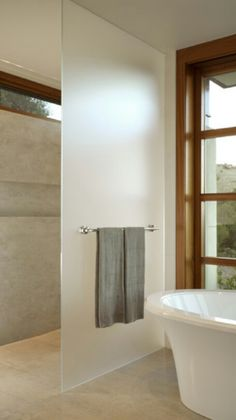 Ensuite Glass Separator. I like the towel rack. Also take note of the window style.