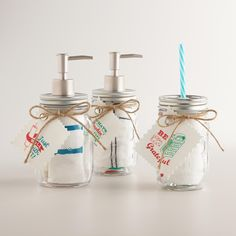 This exclusive hostess or housewarming gift set features a drink-ready mason jar, an oil storage mason jar and a soap dispenser mason jar with a matching cotton dish towel rolled up on the inside, plus a decorative gift tag secured with twine on the outside. >> www.worldmarket.com #WorldMarket Mason Jar Shop