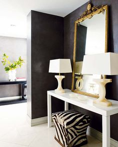 modern space with antique mirror, zebra, wall color on white floors