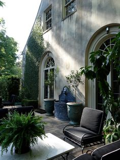 Love the little blue fountain between two potted tress against the wall - maybe use lemongrass instead of the trees