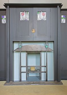 a Fireplace at the House for an Art Lover, Glasgow,  by Charles Rennie Mackintosh