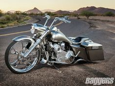 """The beauty and tradition continues to this day with pinup-style art painted on motorcycles such as Jason Ogletree's Custom '09 Road King, appropriately named """"Pin-Up."""""""
