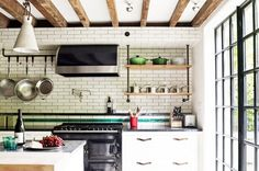 Natural kitchen light and open storage.