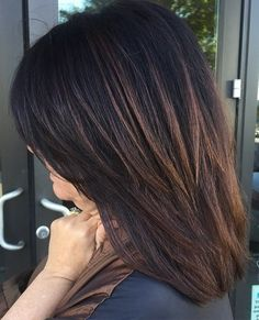 Mid-Length Layered Haircut For Thick Brunette Hair. Subtle medium-brown highlights on dark brown