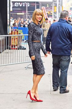 Taylor adds a kick to her Good Morning America outfit with a pair of fiery red heels.   - Seventeen.com