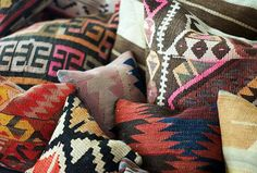 Piles of kilim pillows add instant coziness. We're crazy about the options in this Etsy shop. Photo by Morgan Satterfield via The Brick House