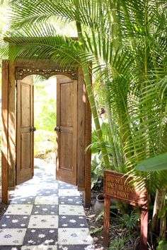 Carved TeakIndonesian Doors and Frame set the mood for the garden.