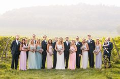 LOVE this wedding's mismatched bridesmaids dresses. All different styles and colors yet they're cohesive and perfect for this spring wedding.  Bohemian Floral Vineyard Wedding http://albertpalmerphotography.com/
