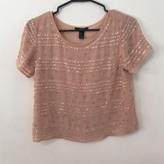 Boxy pink embellished top Top is about 19 inches long from shoulder seam never worn, new without tags Tops Crop Tops