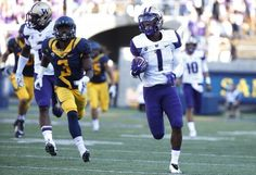 Wide receiver John Ross #1 of the Washington Huskies rushes for an 86-yard touchdown during the second quarter against the California Golden Bears on October 11, 2014 at California Memorial Stadium in Berkeley, California.