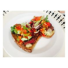 Steak on Griddled Sourdough bread topped with cheese, salad, caramelised balsamic onions & salsa mmmm! @louissmith1989 is the best chef! One of his many talents