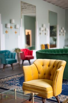Less Is More : Minimalism : Striking colored sitting chairs in a beautifully minimalistic hotel lounge : Classic and simple