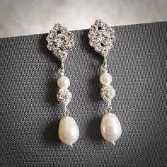 TACIE, Vintage Inspired Oval Rhinestone Wedding Earrings, White, Ivory Swarovski Pearl and Crystal Bridal Dangles, Art Deco Wedding Jewelry. $38.00, via Etsy.