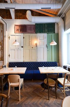 """""""or the new BON restaurant, Corvin used over 200 reclaimed doors, windows and blinds as wall paneling. Corvin has left most of the doors as he found them while only the shades of a few were altered to meet the discreet three tones color scheme of the design (white, blue, red)…"""" (via BON restaurant in Bucharest by Cristian Corvin 