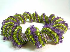 *** 20% OFF ALL READY-MADE ITEMS - WAS $59, NOW $47!! ***    A beautiful twisted bangle bracelet woven of seed beads in shades of purple and