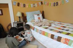 Love the quilt, the white floors, and the fabric banner...