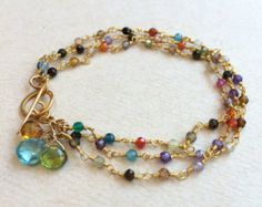 3 strands of tiny cubic zircons surround your wrist in this colorful bracelet. The gold fill toggle makes it easy to get on and off, while Wire Jewelry, Jewelry Crafts, Beaded Jewelry, Jewelery, Handmade Jewelry, Wire Rings, Gemstone Bracelets, Jewelry Bracelets, Leather Bracelets