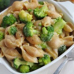 Skinny Creamy Broccoli Shells and Cheese . By @bakingwithblondie . 9oz medium whole grain shell pasta 12oz fresh broccoli florets, diced into small pieces 1/2 t onion powder 1/4 t garlic powder salt and black pepper to taste 3 C low-fat milk 6oz reduce fat sharp cheddar cheese, shredded 1 oz parmesan cheese, shaved