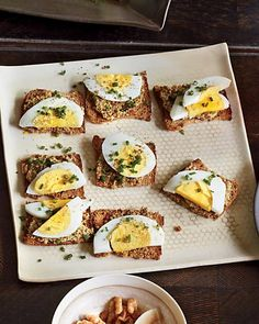 Use whole-grain crackers as stand-ins for traditional tea sandwiches, and top with sliced eggs & mustard, Wholeliving.com