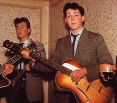 Back in the day: McCartney plays the guitar in 1958 at the wedding reception for his Auntie Jin with John Lennon