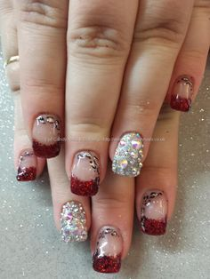 Red glitter tips with freehand nail art and swarovski crystals Taken at:04/01/2014 10:56:22 Uploaded at:05/01/2014 10:06:58 Technician:Elain...