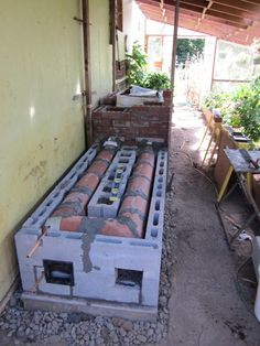 Rocket stove in lean to style green house. Snow on the ground and tomatoes fruiting in pots. This is how it's done.