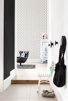 Lattice is a take on the popular trellis pattern with decorative curving linework. It is a great staple in your dining room, living rooms, or hallways. Its simple unadorned nature will allow you to play with other colours and prints while providing the perfect backdrop to make your space stand out. Black and white popular decorative trellis home wallpaper by Walls Republic R2548