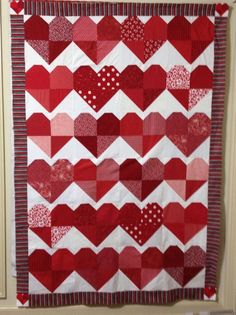 Heart Ball Quilt I donated in 2014. Many of the blocks were made through a QCA block swap.