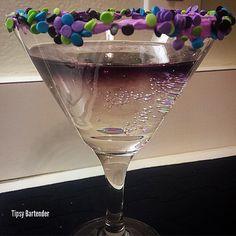 Tipsy BartenderAMETHYST CAKE 2 oz. (60ml) Cake Vodka 1/2 oz. (15ml) Grape Vodka 1 oz. (30ml) Triple Sec 4 oz. (120ml) 7up Stir with ice. Strain into cocktail glass. Add purple food coloring.