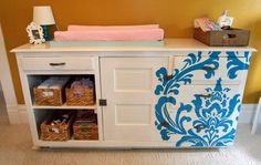 Idea for painted changing table - add a stenciled design for a pop of color!