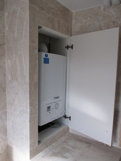We boxed in the boiler a placed an ivory door over the top to match with the units.