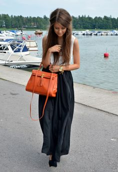 Orange handbag, black skirt, white top