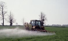 A tractor sprays barley crops: Pesticides are among the toxic chemicals which may be triggering neurological disabilities among children, in. Bayer Ag, How To Kill Bees, Reproductive System, Find People, Fruit And Veg, Alzheimers, Fertility