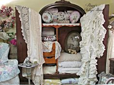 Penny's Vintage Home: Guest Bedroom Mini MakeoverLove the old frame in the armoire