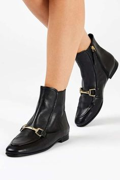 The loafer comes in boot form in this unique take on the currently-trending shoe. These cool black leather versions feature metal detailing to the front and come in an ankle cut fit. #Topshop