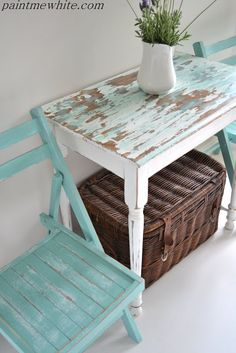 Beachy side table and garden chairs. Simple table given a coastal cottage look by painting with white chalk paint and distressing the top & adding a touch of sea foam green. From Paint Me White.