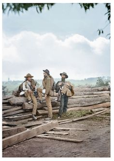Rebel prisoners from Gettysburg. Why do two of the soldiers have coats draped over their shoulder in the middle of July? Why are their haversacks bulging with items? Doesn't it seem odd all three are wearing knapsacks? Especially in July? All of their haversacks and canteen straps appear pretty new. And what is the pieces of rawhide wrapped around the middle soldiers little finger for?