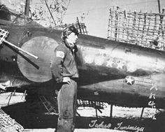 W/O Takeo Tanimizu, JNAF ace with 32 victories and 1,435 flight hours, beside his Mitsubishi A6M5 fighter.
