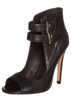 ALDO KAY http://pixiie.net/shop/aldo-kay-peeptoe-heels-black/