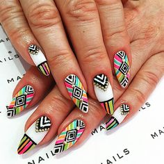 Loving these super fly neon colored Tribal Nails hand painted with round gold studs by my girl @aya84ichigo from @marienails Koreatown she's an AMAZING nail artist! #nailart #nail #nails #neon #neonnails #NailDesigns #nailfashion #nailfeature #neonnailart #neonnailsummer #neonnailspolish #InStyle #fashion #studs  #tribalnails #tribal #tribalprint #tribalnsilart #japanesenail #japanesenailart #japanesenailsalon #sekhmetkamaat #onelifecampaign #Aya #MarieNails #LosAngeles #NewYork #japan…