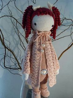 An amazing creation by Tienke Vis.  Such an elegant coat, girly details, amazing hair!  Check out the darling shoes!
