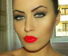 i LOVE this look! The eyes are PERFECT with the red lips <3... I'd go for a cooler red though.. LOVE!