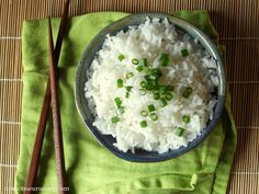 Thai coconut rice, prepared by simmering jasmine rice in coconut milk. A delicious side for stir-fries and curries.