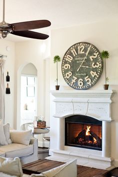 the little cottage on the pond...love the big clock over the fireplace