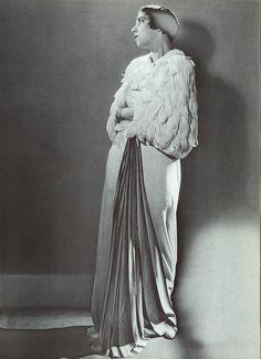 Elsa Schiaparelli wearing her own design, 1934, by Man Ray
